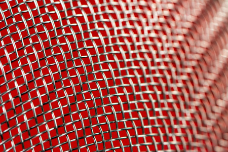 rustproof: Abstract macro background of a sieve with selective focus