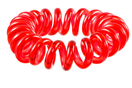 scrunchie: Eelastic red spiral hari tie isolated on white