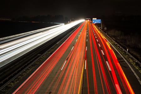 autobahn: Light trails on a german Autobahn (Highway) at the motorway exit Pfaffenhofen.
