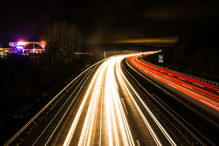 Light trails on a german Autobahn (Highway) at the motorway exit Pfaffenhofen. photo