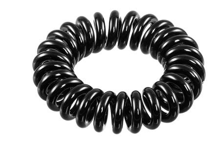 scrunchie: Eelastic black spiral hari tie isolated on white Stock Photo