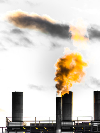 smokestack: Air pollution from an smokestack of an old factory