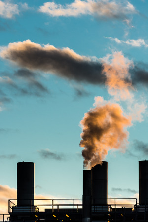 air pollution: Air pollution from an smokestack Stock Photo