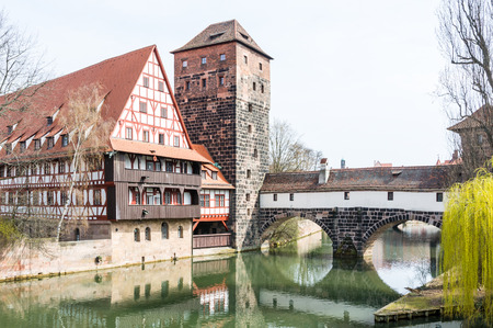 The Wasserturm (water tower, built 13th century)  and the Weinstadl (Former Wine Depot, built 15th century) - medieval buildings in historic Nuremberg photo