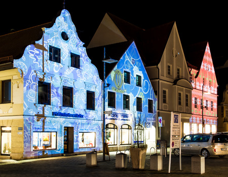 hauptplatz: PFAFFENHOFEN, GERMANY - DEZEMBER 21: Illuminated house facades in Pfaffenhofen, Germany on Dezember 21, 2014. In the Advent all houses of the old town are lighted with christmassy pirctures. Foto taken from Hauptplatz.