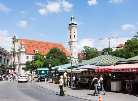 20 year old: MUNICH, GERMANY - JULY 20: Tourists at the Viktualienmarkt in Munich,  Germamy on July 20, 2015. Munich is the biggest city of Bavaria with almost 100 million visitors a year. Foto taken from Viktualienmarkt with view to the old town hall.