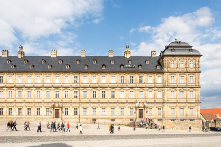 residenz: BAMBERG, GERMANY - SEPTEMBER 4: Tourists at Neue Residenz in Bamberg, Germany on September 4, 2015. The Neue Residenz was the former residence of the bishops of Bamberg. Foto taken from Domplatz with view to the residence.