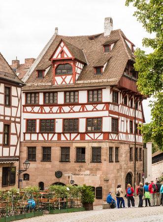 albrecht: NUERNBERG, GERMANY - SEPTEMBER 5: Tourist in front of the Albrecht Duerer House in Nuernberg, Germany on September 5, 2015. This was the home of the famous painter and mathematician Albrecht Duerer. Foto taken from Albrecht Duerer Street.
