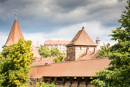 12th century: NUERNBERG, GERMANY - SEPTEMBER 5: The Kaiserburg in Nuernberg, Germany on September 5, 2015. The famous medieval castle was built in the 12th century. Foto taken from Spittlertorgraben.