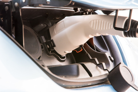 recharging: Recharging of an an electric car with a plug and cable