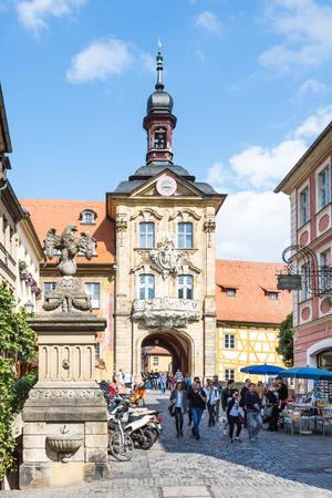 rathaus: BAMBERG, GERMANY - SEPTEMBER 4: Tourists at Altes Rathaus in Bamberg, Germany on September 4, 2015. The historic town hall was built in the 14th century. Foto taken from Karolinenstrasse with view to Altes Rathaus.