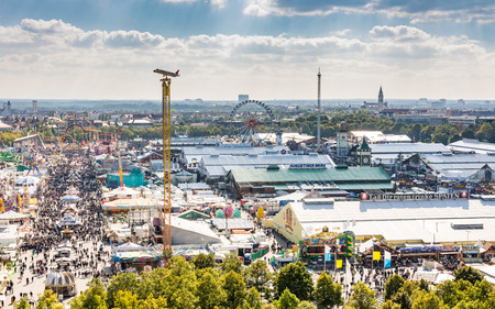 MUNICH, GERMANY - SEPTEMBER 30: View over the Oktoberfest in Munich, Germany on September 30, 2015. The Oktoberfest is the biggest beer festival of the world with over 6 million visitors each year. Foto taken from Paulskirche.