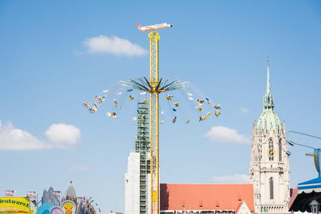 chairoplane: MUNICH, GERMANY - SEPTEMBER 30: People in a high chairoplane on the Oktoberfest in Munich, Germany on September 30, 2015. The Oktoberfest is the biggest beer festival of the world with over 6 million visitors each year. Foto taken from Theresienwiese.