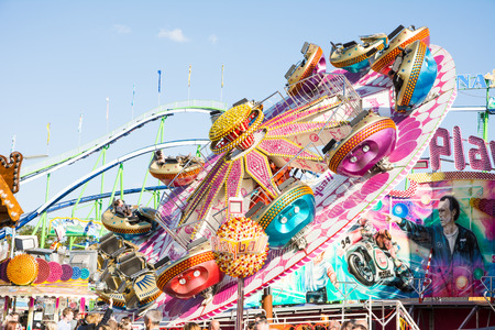MUNICH, GERMANY - SEPTEMBER 30: Fairground rides at the Oktoberfest in Munich, Germany on September 30, 2015. The Oktoberfest is the biggest beer festival of the world with over 6 million visitors each year. Foto taken from Theresienwiese.
