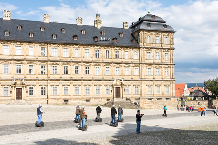 residenz: BAMBERG, GERMANY - SEPTEMBER 4: Segway tour at Neue Residenz in Bamberg, Germany on September 4, 2015. The Neue Residenz was the former residence of the bishops of Bamberg. Foto taken from Domplatz with view to the residence.