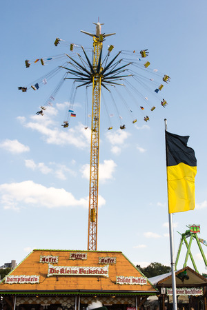 MUNICH, GERMANY - SEPTEMBER 30: People in a high chairoplane on the Oktoberfest in Munich, Germany on September 30, 2015. The Oktoberfest is the biggest beer festival of the world with over 6 million visitors each year. Foto taken from Theresienwiese.