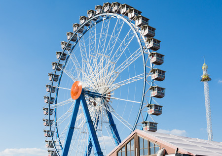 each year: MUNICH, GERMANY - SEPTEMBER 30: Ferris wheel on the Oktoberfest in Munich, Germany on September 30, 2015. The Oktoberfest is the biggest beer festival of the world with over 6 million visitors each year. Foto taken from Theresienwiese.