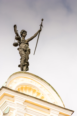 justitia: Justitia (Lady Justice) sculpture on the old town hall in Ingolstadt, built 1883.
