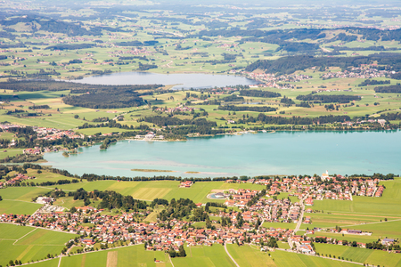 schwangau: Aerial view from mount Tegelberg over lake Forggensee and the village of Schwangau in Bavaria (Germany)