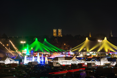 MUNICH, GERMANY - DECEMBER 12: Illuminated tents at the Tollwood winter festival in Munich, Germany on December 12, 2015.  Foto taken from Theresienwiese with view to the festival tents.