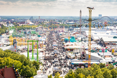 chairoplane: MUNICH, GERMANY - SEPTEMBER 30: View over the Oktoberfest in Munich, Germany on September 30, 2015. The Oktoberfest is the biggest beer festival of the world with over 6 million visitors each year. Foto taken from Paulskirche.
