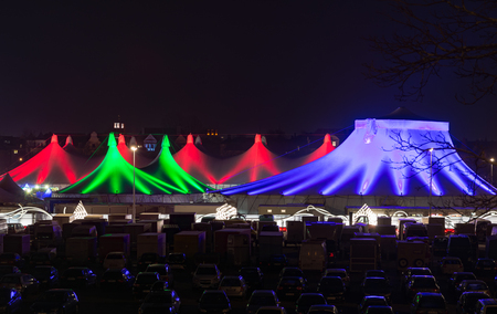 christkindlmarkt: MUNICH, GERMANY - DECEMBER 12: Illuminated tents at the Tollwood winter festival in Munich, Germany on December 12, 2015.  Foto taken from Theresienwiese with view to the festival tents.