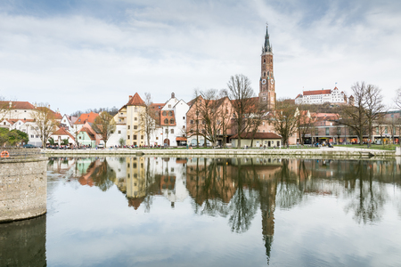 landshut: LANDSHUT, GERMANY - MARCH 31. Basilica St. Martin in Landshut, Germany on March 31, 2016. The basilica St. Martin on the right has the highest clinker tower of the world. Foto taken from Ludwigswehr with view to the basilica. Editorial