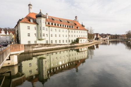 landshut: LANDSHUT, GERMANY - MARCH 31. Spital Heilig Geist in Landshut, Germany on March 31, 2016. The historic building was built in the 18th century. Foto taken from Altstadt bridge with view to the Spital Heilig Geist.