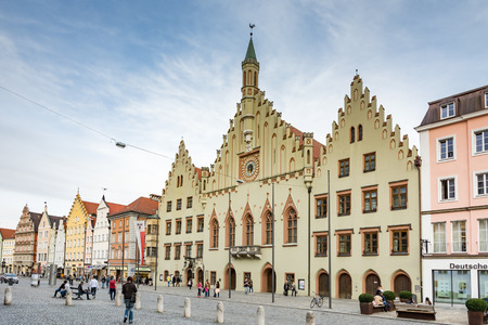 landshut: LANDSHUT, GERMANY - MARCH 31. Tourists at the historic town hall in Landshut, Germany on March 31, 2016. Landshut is the largest city of lower Bavaria. Foto taken from Altstadt with view to the town hall.