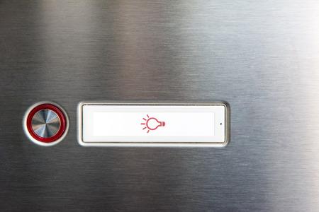 mettalic: Closeup of a doorbell on a mettalic plate