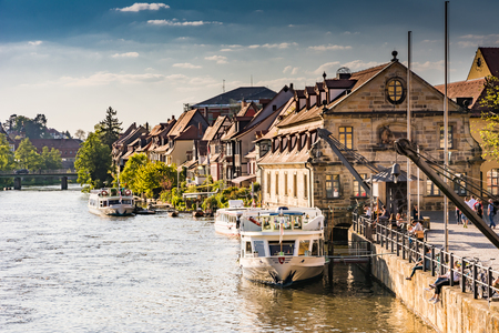 passenger ship: BAMBERG, GERMANY - MAI 6: Passenger ship at river Regnitz in Bamberg, Germany on Mai 6, 2016. Bamberg is a UNESCO world heritage site. Foto taken from Untere Bruecke with view to Am Kranen.