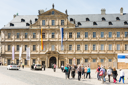 residenz: BAMBERG, GERMANY - MAI 6: Tourists at Neue Residenz in Bamberg, Germany on Mai 6, 2016. The Neue Residenz was the former residence of the bishops of Bamberg. Foto taken from Domplatz with view to the residence.
