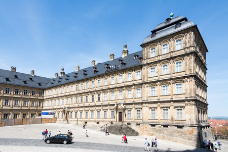 residenz: BAMBERG, GERMANY - MAY 6: Tourists at Neue Residenz in Bamberg, Germany on May 6, 2016. The Neue Residenz was the former residence of the bishops of Bamberg. Foto taken from Domplatz with view to the residence. Editorial