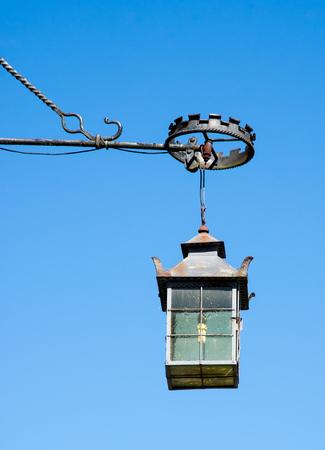 rustiness: Vintage rusty lantern and blue sky