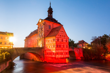 14th century: Illuminated historic town hall of Bamberg, built in the 14th century. Stock Photo