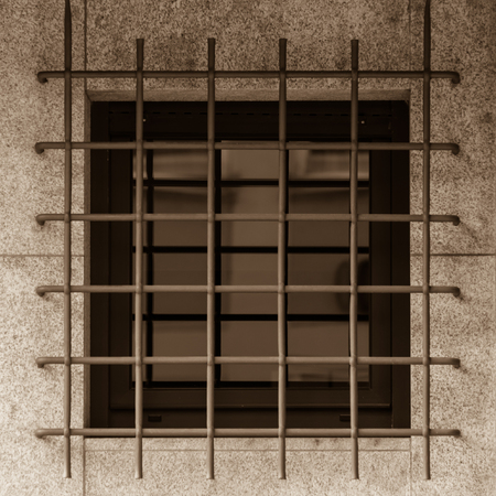grille: Jailhouse window with rusty iron grille Stock Photo