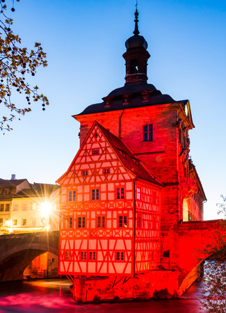 Illuminated historic town hall of Bamberg, built in the 14th century. Stock Photo