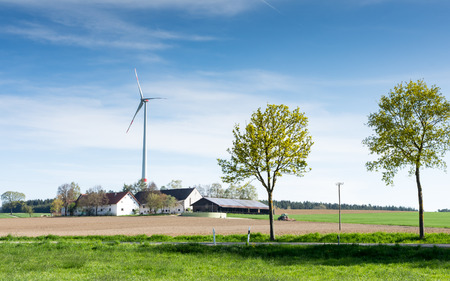 energies: Alternative energy with a windmill at a farm