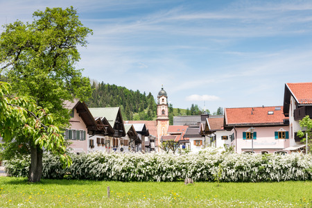 MITTENWALD, GERMANY - MAY 27: Historic houses in the village of Mittenwald, Germany on May 27, 2016. Mittenwald is famous for the manufacture of violins, violas and cellos. Foto taken from Obermarkt with view to the town. Editorial