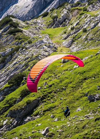 adrenalin: GARMISCH, GERMANY - JULY 10: Paraglider at the Osterfeldkopf mountain in Garmisch, Germany on July 10, 2016.