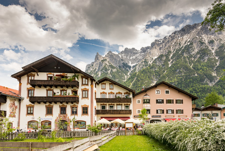 cellos: MITTENWALD, GERMANY - MAY 27: Historic houses in the village of Mittenwald, Germany on May 27, 2016. Mittenwald is famous for the manufacture of violins, violas and cellos. Foto taken from Obermarkt with view to the town. Editorial
