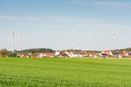 energies: Alternative energy with windmills at a village Stock Photo