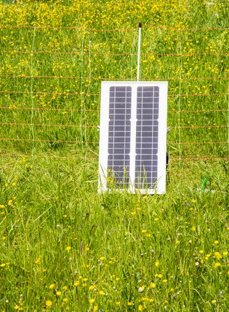 pasture fence: Electric pasture fence charged with a solar panel Stock Photo