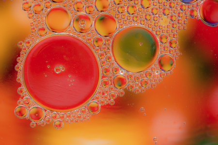 liquidity: Colorful abstract macro background with oil drops in water Stock Photo