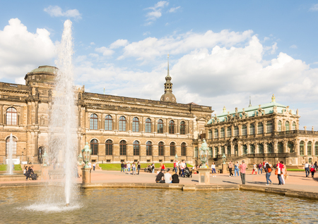 largely: DRESDEN, GERMANY - AUGUST 22: Tourists at the Zwinger palace in Dresden, Germany on August 22, 2016. By 1963 the Zwinger had largely been restored after it was completely destroyed 1945. Foto taken from the public Zwinger park.