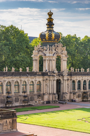 largely: DRESDEN, GERMANY - AUGUST 22: Zwinger palace in Dresden, Germany on August 22, 2016. By 1963 the Zwinger had largely been restored after it was completely destroyed 1945. Foto taken from the public Zwinger park.