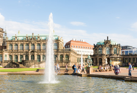 DRESDEN, GERMANY - AUGUST 22: Tourists at the Zwinger palace in Dresden, Germany on August 22, 2016. By 1963 the Zwinger had largely been restored after it was completely destroyed 1945. Foto taken from the public Zwinger park.