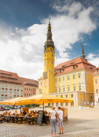 BAUTZEN, GERMANY - AUGUST 23: Tourists at the town hall of Bautzen, Germany on August 23. Bautzen is a hill-top town in eastern Saxony. Foto taken from Hauptmarkt with view to the town hall.