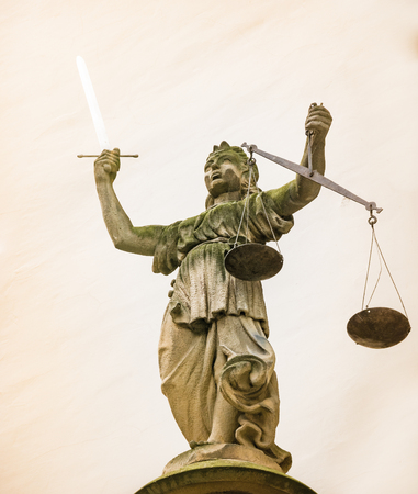 justitia: Sculpture of Lady Justice (Justitia) from 1591 at the old town hall of Goerlitz Stock Photo