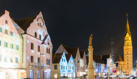 hauptplatz: PFAFFENHOFEN, GERMANY - DEZEMBER 11: Illuminated house facades in Pfaffenhofen, Germany on Dezember 11, 2016. In the Advent all houses of the old town are lighted with christmassy pirctures. Foto taken from Hauptplatz.